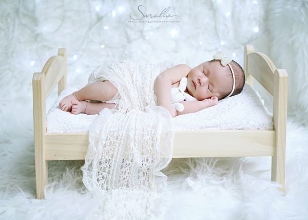 white newborn on bed