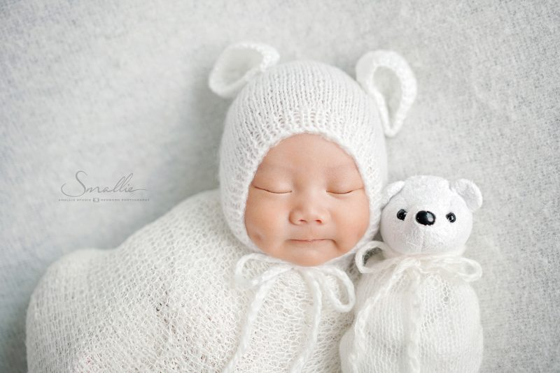white newborn on bed
